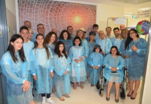 Gideon Paull of California and his brother Jonathan, of the UK, and members of their extended family, at the dedication of a Mother's Milk Room at the Shaare Zedek NICU in memory of their late mother, and in honor of the exemplary treatment she received at Shaare Zedek in her final days.